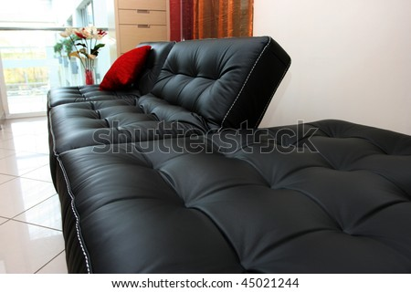 Black leather sofa in office