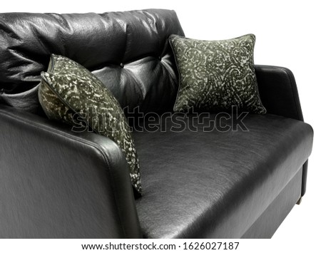 Black leather sofa. Sofa isolated on white background. Including clipping path. Fragment