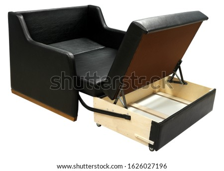 Black leather sofa. Sofa isolated on white background. Opened storage for bed linen. Including clipping path