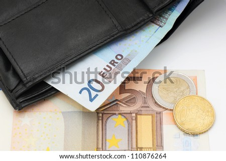 Black leather wallet and money euro.