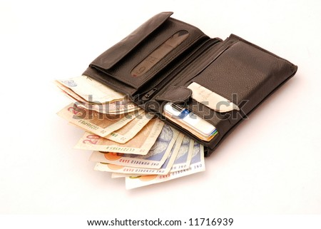 Black leather wallet full of one hundred South African Rand bills isolated on white background