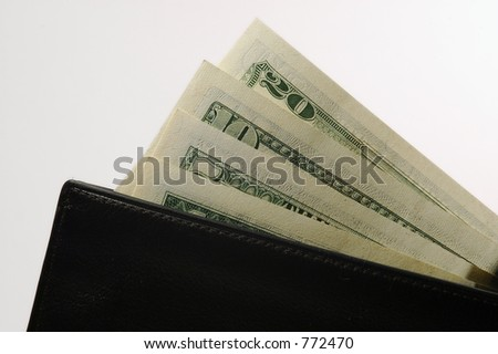 Black leather wallet with money. White background.