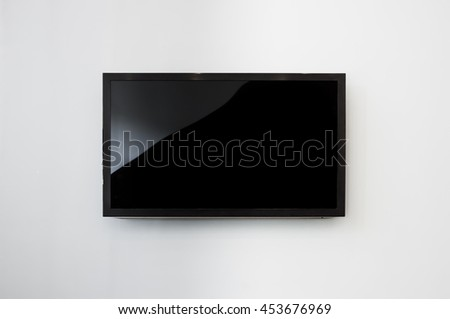 Black LED tv television screen mockup / mock up, blank on white wall background #453676969