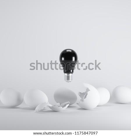 Black lightbulb floating born from white Egg on white blackground. minimal idea concept.