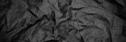 Black linen fabric texture. Crumpled cloth textile background. Draped raw organic cloth black pattern, banner