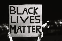 Black lives matter banner - Activist movement protesting against racism and fighting for equality - Social protests and human rights concept - Black and white editing