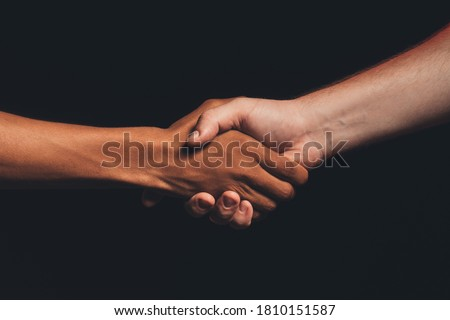 Black lives matter. Human tolerance. Unrecognizable multicolor male hands shaking isolated on dark copy space. Ethnic friendship. No racism. Races agreement Stock fotó ©