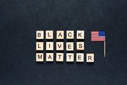 Black lives matter inscription on a black background. protests. unrest. hashtag Blacklivesmatter. American flag. USA