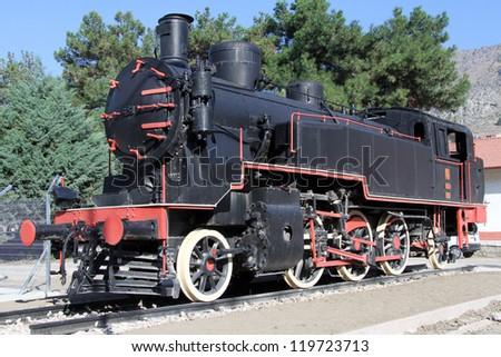 Black locomotive near train station in Amasya, Turkey