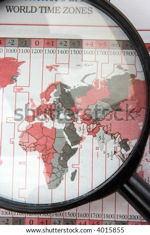 black magnifier on world map with time zones