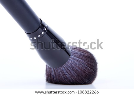 black make-up brushes on white background - stock photo