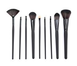 Black makeup brushes isolated on white background