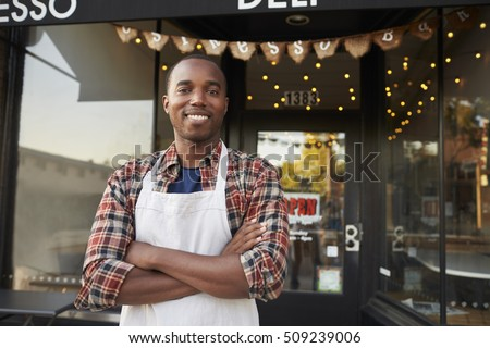 Black male business owner standing outside coffee shop #509239006