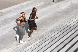 Black Man And Woman Jogging Together In Urban Park, Running Up Steps, Working Out Outdoors, Empty Space