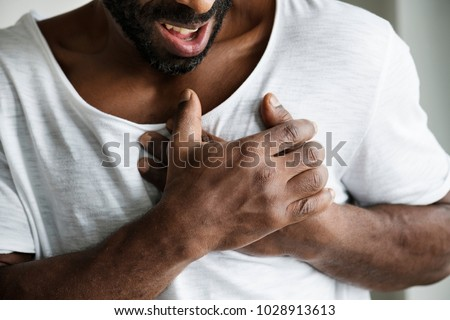 Black man having a heart attack