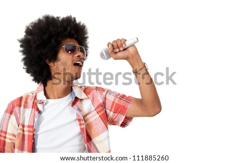 Black man holding a microphone and singing - isolated over a white background