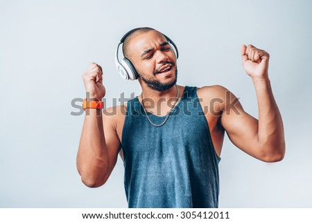 black man listening to music on headphones #305412011