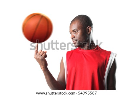 Black man playing with a basketball