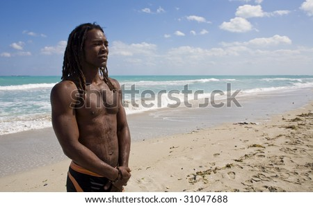 black man thinking on the beach back in the blue sea over blue sky