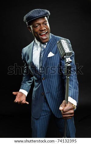 Black man with blue striped suit and cap singing. Jazz musician. Night club. Cotton club. New Orleans.