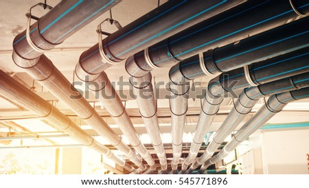Black manage water pipe, safety and clean watering system in condominium or modern building construction.