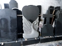 black marble, granite stone tombstones are stored and put on sale