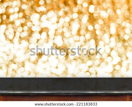 Black marble Table with bokeh golden sparkling background,Empty room for display your product