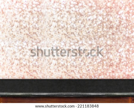 Black marble Table with bokeh pink sparkling background,Empty room for display your product