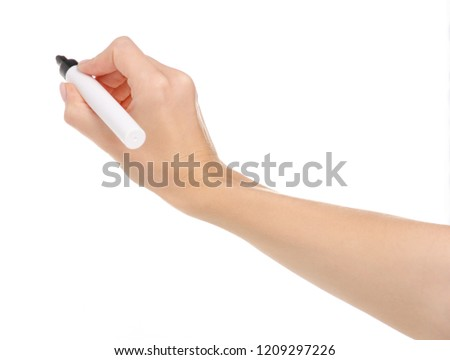 Black marker in hand on a white background. Isolation