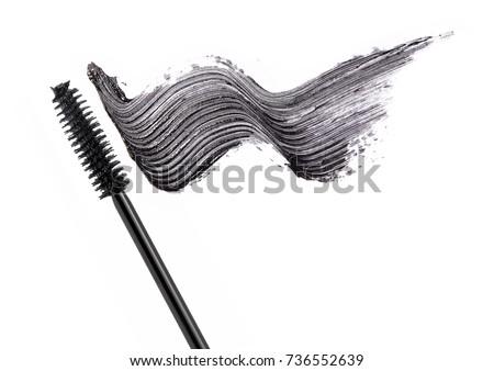 Black mascara brush stroke with applicator brush  isolated on white