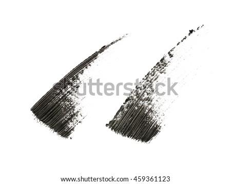 Black mascara brush strokes on background