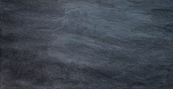 Black mat textured solid stone slab background.