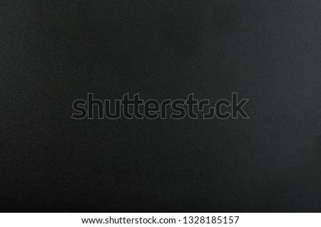 Black matte background. Surface of abstract dark texture