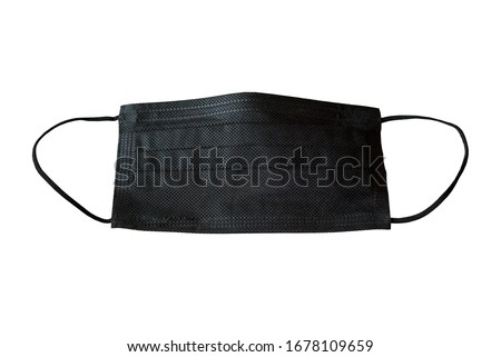 Black medical facial mask isolated on white background closeup. Covid-19, pollution, virus and flu protection concept. Professional surgical equipment.