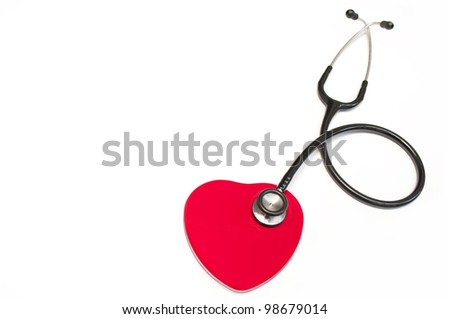 Black medical stethoscope and heart isolated on white - stock photo