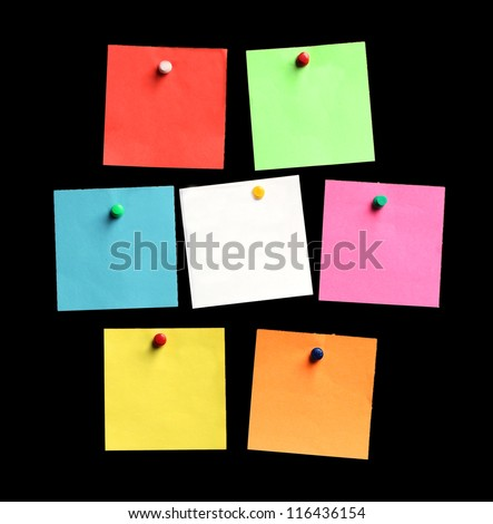 black memo board with colorful paper sheets