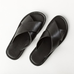 Black men's leather sandals on a white background, top view