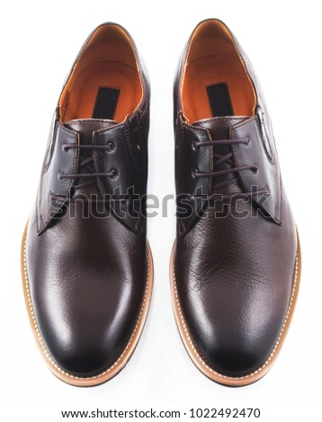 Black men's leather shoes isolated on white background #1022492470