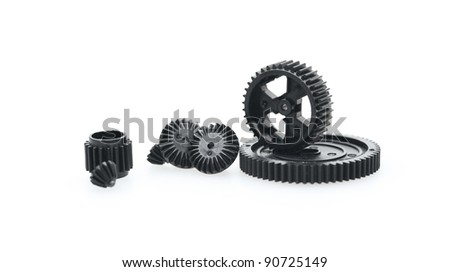 Black metal gear wheels of the different size on a white background