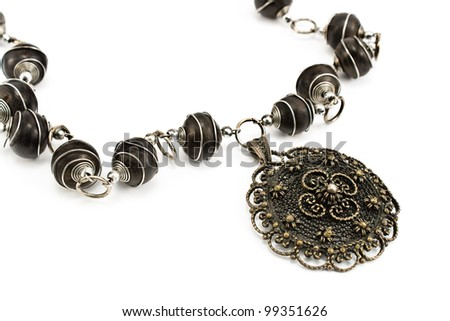 Black metal necklace with pendant isolated on white