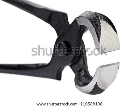 Black metal nippers on white