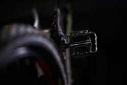 Black metal pedal on a bike with hard light. Bike accessories