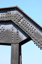 black metal steel post structure with rivets and nuts.  crossing metal railway construction at the River kwai bridge, Kanchanaburi Province, world war 2.