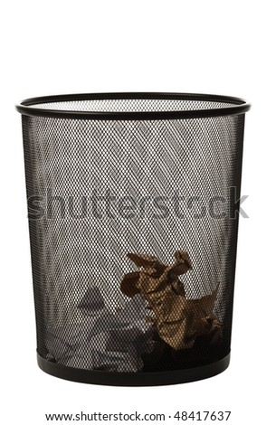 Black metallic office trash basket isolated on white with some papers in