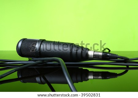 black microphone cable on the glass