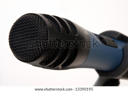 black microphone grid close-up  over white - stock photo