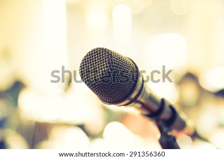 Black microphone in conference room Filtered image processed vintage effect