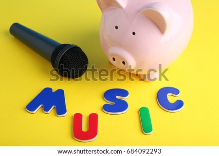 Black microphone with piggybank and inscription Music #684092293