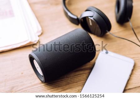 Black mini wireless portable bluetooth speaker for music listening.  Сток-фото ©