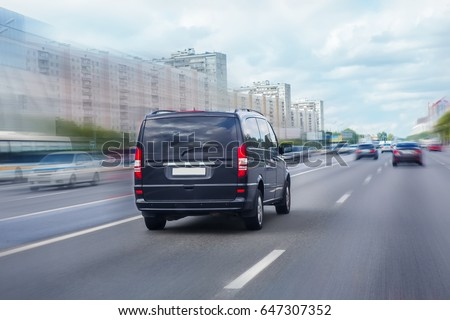 black minivan is moving on the highway in the city Stock photo ©